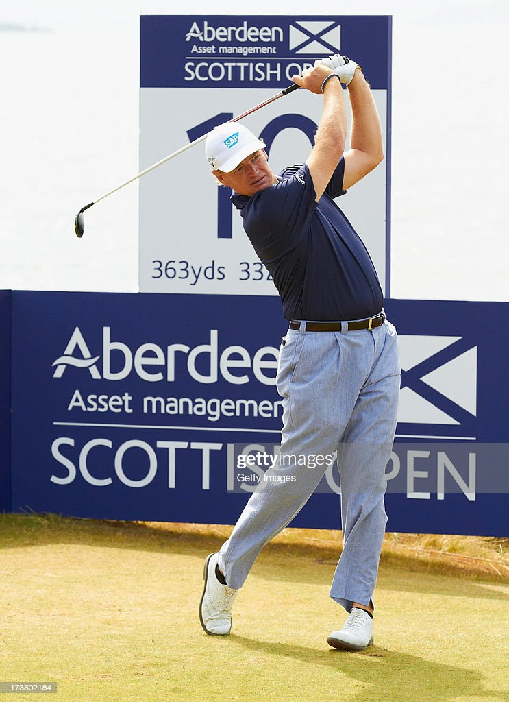 <a gi-track='captionPersonalityLinkClicked' href=/galleries/search?phrase=Ernie+Els&family=editorial&specificpeople=162688 ng-click='$event.stopPropagation()'>Ernie Els</a> of South Africa tees off during the first round of the Aberdeen Asset Management Scottish Open at Castle Stuart Golf Links on July 11, 2013 in Inverness, Scotland.