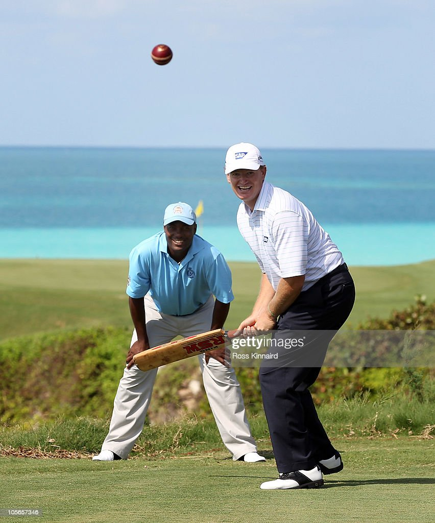 Ernie Els of South Africa tries his had at cricket with former test star Brian Lara keeping wicket during the pro-am event prior to the PGA Grand Slam of Golf at Port Royal Golf Course on October 18, 2010 in Southampton, Bermuda.