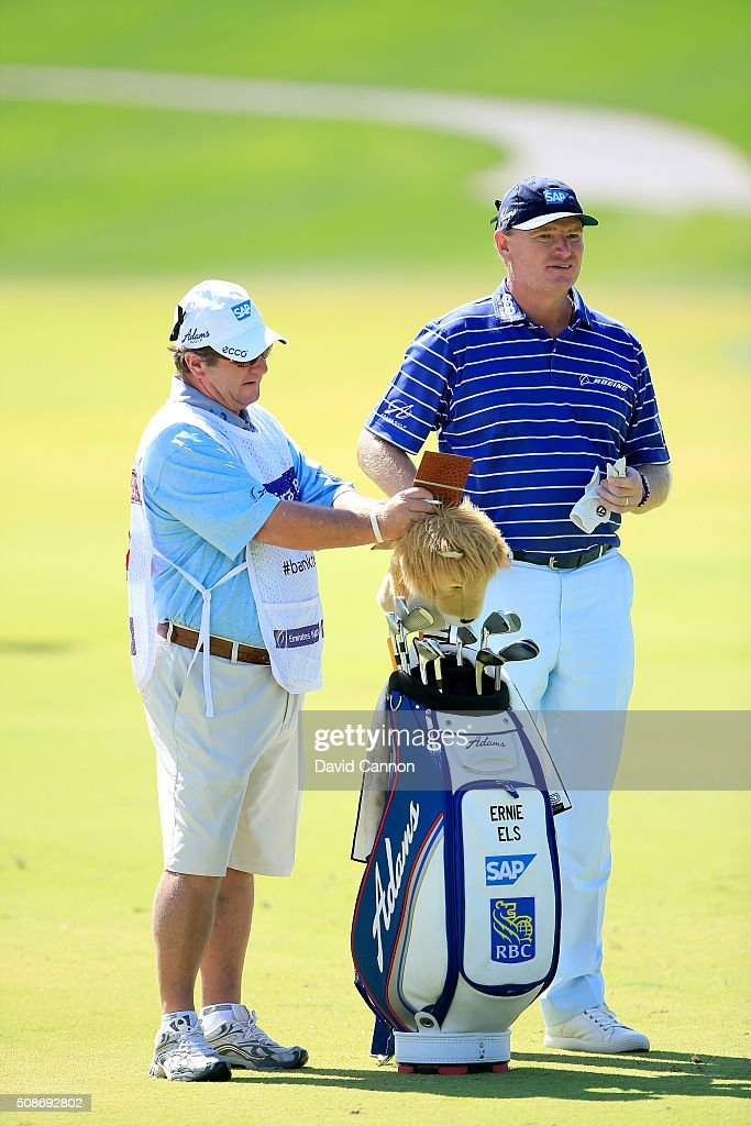 Ernie Els of South Africa waits to play his second shot at the par 4, first hole with his caddie Ricci Roberts during the third round of the 2016 Omega Dubai Desert Classic on the Majlis Course at the Emirates Golf Club on February 6, 2016 in Dubai, United Arab Emirates.