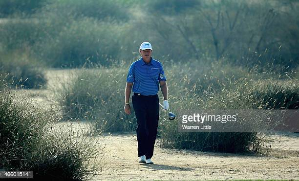 Ernie Els of South Africa walks through the desert during the second round of the 2014 Omega Dubai Desert Classic on the Majlis Course at the...