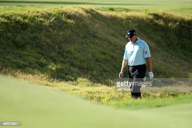 Ernie Els of South Africa walks through the rough in the first round of the Northern Trust Open at the Riviera Country Club on February 13 2014 in...