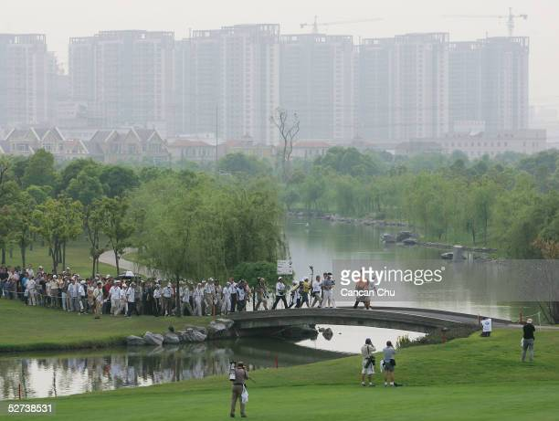 Ernie Els of South Africa walks towards the 18th hole followed by his fans during the third round of the BMW Asian Open on April 30 2005 at the...