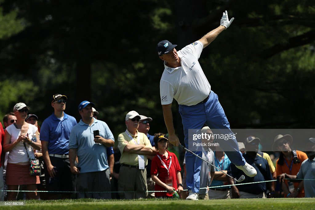 Ernie Els of South Africa watches his shot from the second tee during the final round of the Quicken Loans National at Congressional Country Club on June 26, 2016 in Bethesda, Maryland.
