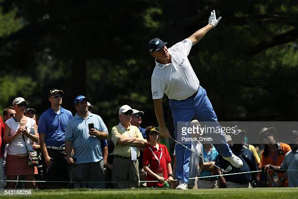 Ernie Els of South Africa watches his shot from the second tee during the final round of the Quicken Loans National at Congressional Country Club on...