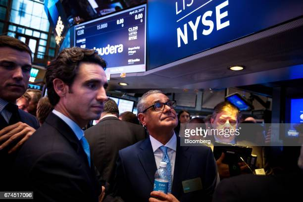 Ernie Garcia III founder and chief executive officer of Carvana Co second left and his father Ernest Garcia II chairman of Carvana Co center stand...