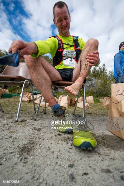 Ernst Staale Apeland changing his socks and shoes at one of the aid stations at Hardangervidda Marathon on September 2 2017 in Eidfjord Norway...