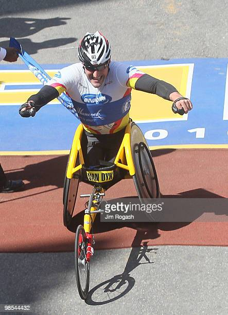 Ernst Van Dyk crosses the finish line to win the mens wheelchair division of the 114th Boston Marathon on April 19 2010 in Boston Massachusetts
