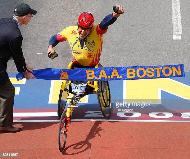 Ernst Van Dyk of South Africa crosses the finish line to win the men's wheel chair division of the 112th Boston Marathon on April 21 2008 in Boston...