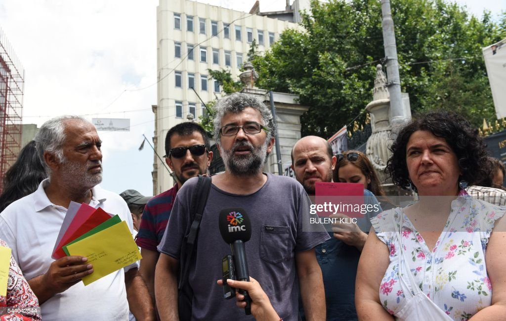 Erol Onderoglu, representative in Turkey for Reporters Without Borders (RSF), speaks to the press on July 1, 2016 in Istanbul, after being released with conditions after he was detained 10 days ago on 'terrorist propaganda' charges. RSF chief Christian Deloire confirmed the release of Erol Onderoglu to AFP, while local media said rights activist and academic Sebnem Korur Fincanci had also been freed. / AFP / BULENT