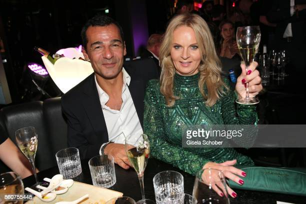 Erol Sander and Phoebe Rocchi during the grand opening of Roomers IZAKAYA on October 12 2017 in Munich Germany