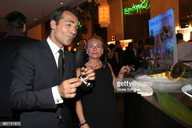 Erol Sander tastes caviar during the 2oth 'Busche Gala' at The Charles Hotel on October 16 2017 in Munich Germany