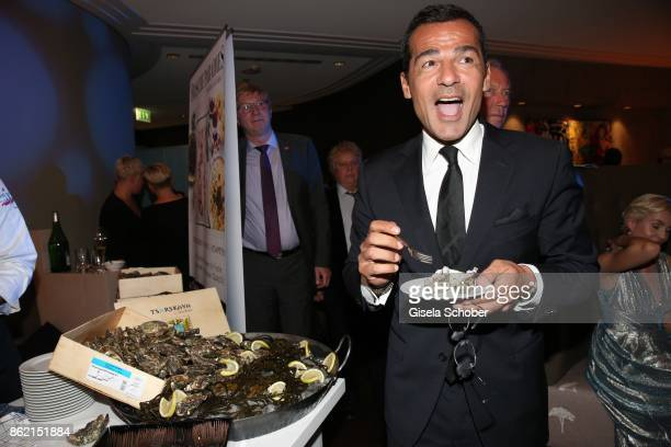 Erol Sander tastes oysters during the 2oth 'Busche Gala' at The Charles Hotel on October 16 2017 in Munich Germany