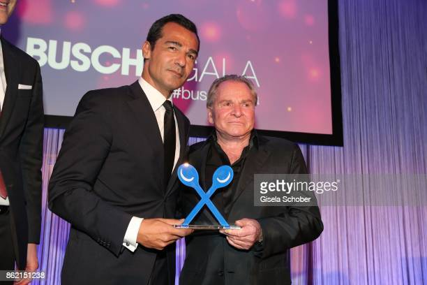 Erol Sander with award and Fritz Wepper during the 2oth 'Busche Gala' at The Charles Hotel on October 16 2017 in Munich Germany