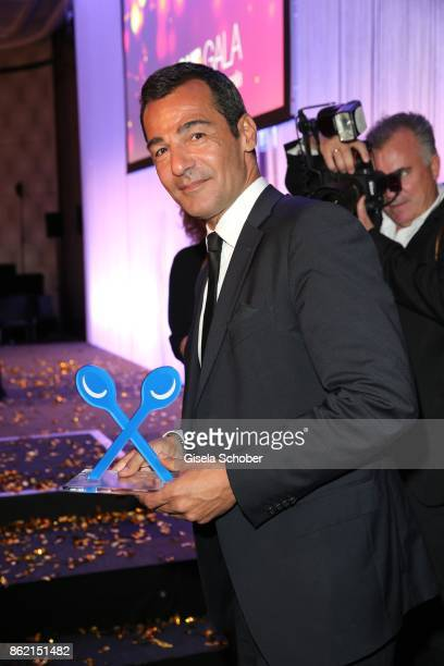 Erol Sander with award during the 2oth 'Busche Gala' at The Charles Hotel on October 16 2017 in Munich Germany