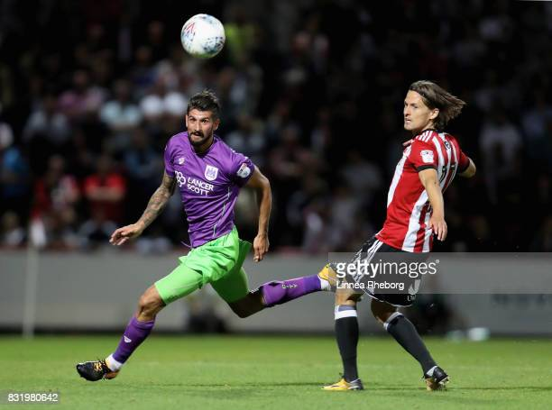 Eros Pisano of Bristol City and Lasse Vibe of Brentford compete for the ball during the Sky Bet Championship match between Brentford and Bristol City...