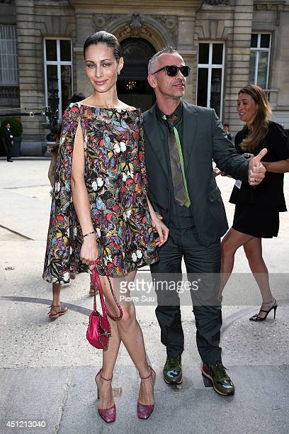Eros Ramazzotti and his wife Marica Pellegrinelli attend the Valentino show as part of the Paris Fashion Week Menswear Spring/Summer 2015 on June 25...