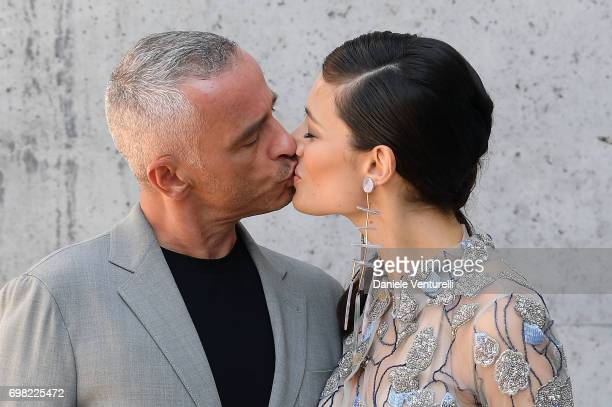 Eros Ramazzotti and Marica Pellegrinelli attends the Giorgio Armani show during Milan Men's Fashion Week Spring/Summer 2018 on June 19 2017 in Milan...