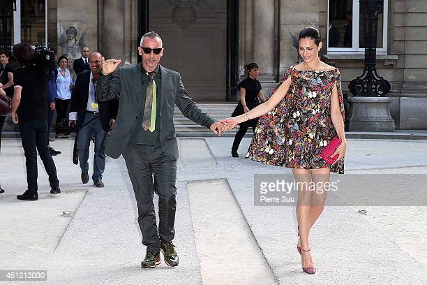 Eros Ramazzottti and his wife Marica Pellegrinelli attend the Valentino show as part of the Paris Fashion Week Menswear Spring/Summer 2015 on June 25...