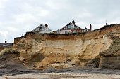 Homes on the cliff edge at Happisburgh in Norfolk demonstrating levels of erosion along the East Coast.