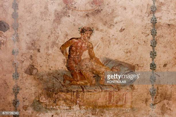 POMPEI POMPEII CAMPANIA ITALY Erotic frescos in the Little Lupanare in Pompeii archaeological area The ancient Roman town of Pompeii was buried...