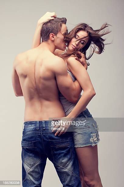 Erotic young couple in jeans dancing passionately
