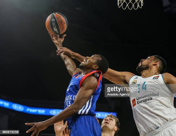 Errick Mccollum of Anadolu Efes in action against Gustova Ayon of Real Madrid during the Turkish Airlines Euroleague basketball match between Anadolu...