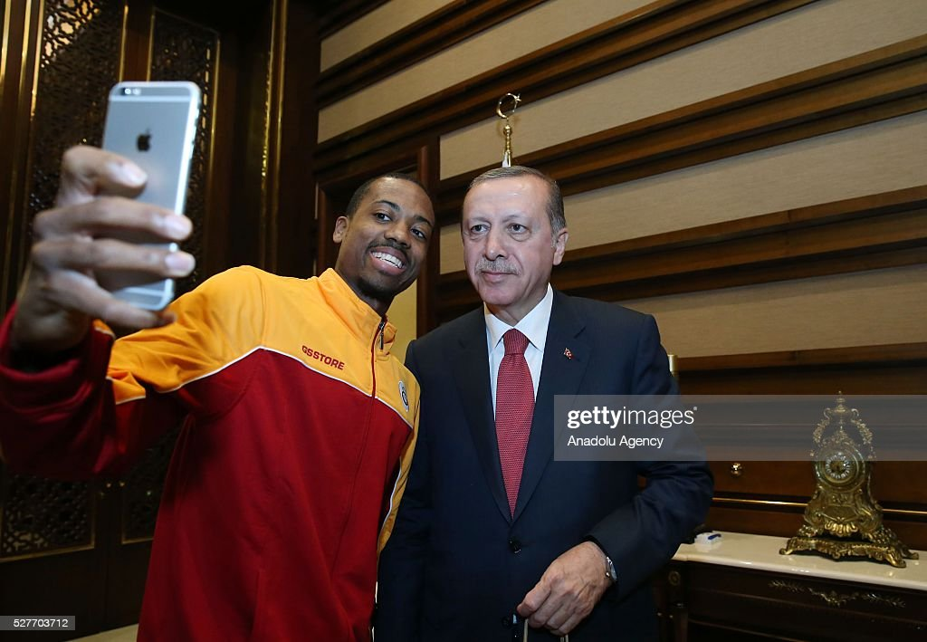 Errick McCollum (L) player of Galatasaray Men's Basketball Team takes selfie with Turkish President Recep Tayyip Erdogan (R) at Presidential Complex in Ankara, Turkey on May 3, 2016.