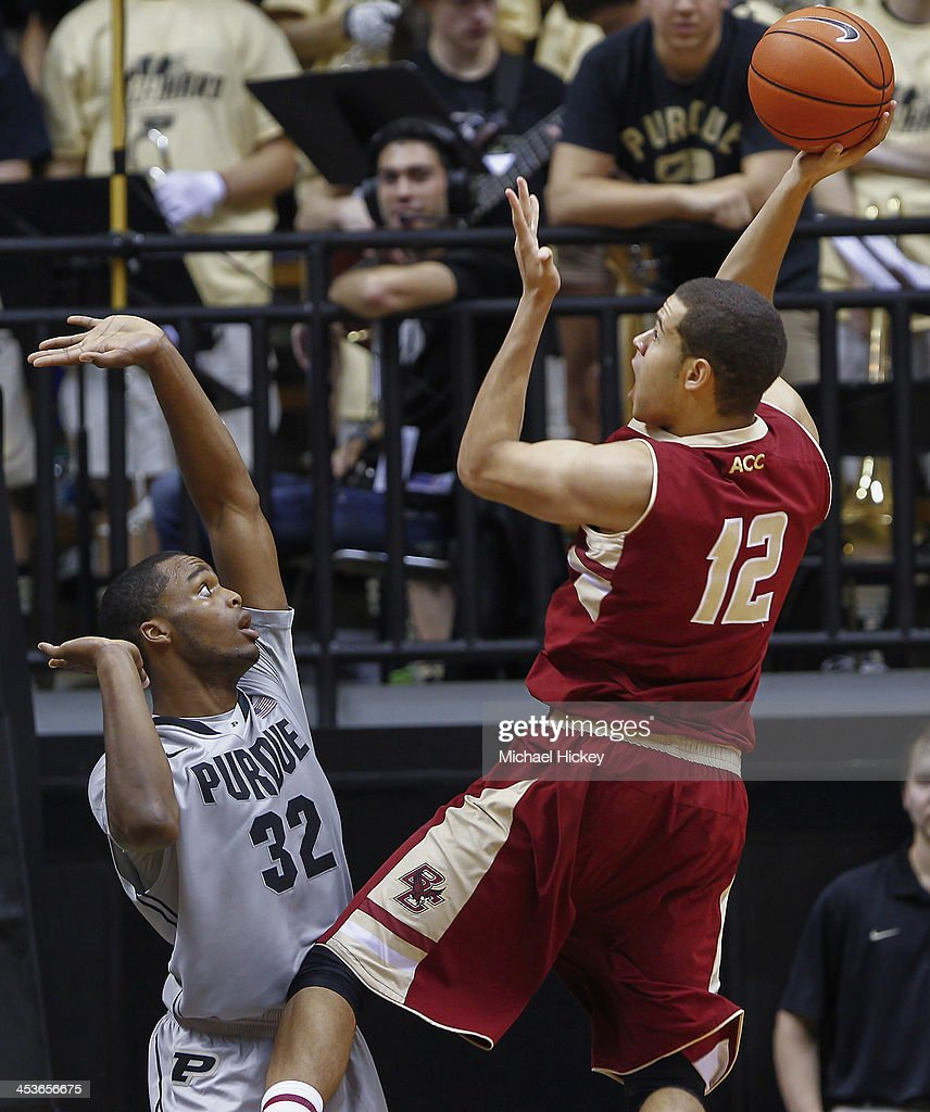 Errick Peck #32 of the Purdue Boilermakers defends as Ryan Anderson #12 of the Boston College Eagles shoots a one handed jumper at Mackey Arena on December 4, 2013 in West Lafayette, Indiana. Purdue defeated Boston College 88-67.