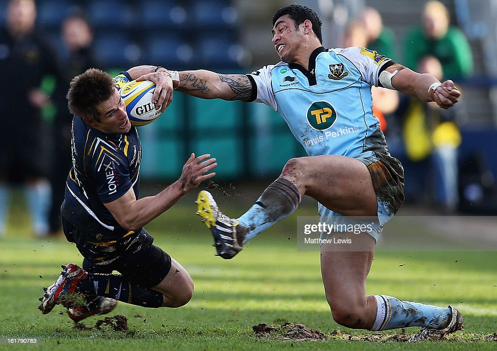 Errie Claassens of Worcester is caught by <a gi-track='captionPersonalityLinkClicked' href=/galleries/search?phrase=George+Pisi&family=editorial&specificpeople=783455 ng-click='$event.stopPropagation()'>George Pisi</a> of Northampton during the Aviva Premiership match between Worcester Warriors and Northampton Saints at Sixways Stadium on February 16, 2013 in Worcester, England.