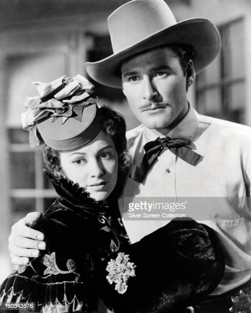 Errol Flynn as Wade Hatton and Olivia de Havilland as Abbie Irving in a promotional still for 'Dodge City' directed by Michael Curtiz 1939