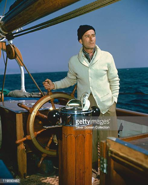 Errol Flynn Australian actor at the wheel of his schooner 'The Zaca' in a publicity still issued for the film 'Cruise of the Zaca' 1952 The...