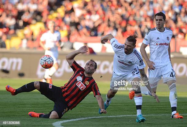 Ersan Adem Gulum of Besiktas vies for the ball with Theofanis Gekas of Eskisehirspor during the Turkish Spor Toto Super League football match between...