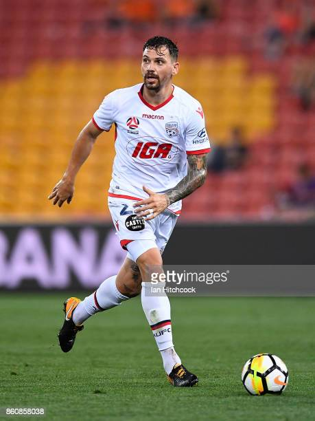 Ersan Gulum of Adelaide United dribbles the ball during the round two ALeague match between the Brisbane Roar and Adelaide United at Suncorp Stadium...