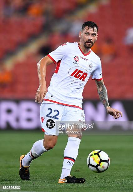 Ersan Gulum of Adelaide United kicks the ball during the round two ALeague match between the Brisbane Roar and Adelaide United at Suncorp Stadium on...