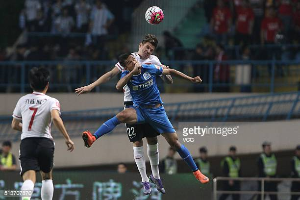 Ersan Gulum of Hebei China Fortune and Wang Jianan of Guangzhou RF compete for the ball during the Chinese Football Association Super League match...