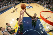 Ersan Ilyasova and Larry Sanders of the Milwaukee Bucks rebound against the Memphis Grizzlies on February 1 2014 at FedExForum in Memphis Tennessee...