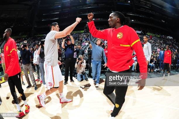 Ersan Ilyasova and Taurean Prince of the Atlanta Hawks shake hands before the game against the Portland Trail Blazers on March 18 2017 at Philips...