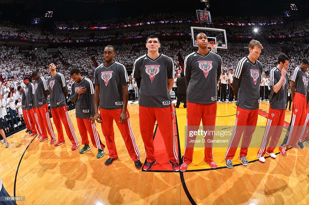 Ersan Ilyasova #7 and the Milwaukee Bucks line up before the game against the Miami Heat in Game One of the Eastern Conference Quarterfinals during the 2013 NBA Playoffs on April 21, 2013 at AmericanAirlines Arena in Miami, Florida.