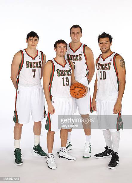 Ersan Ilyasova Beno Udrih Andrew Bogut and Carlos Delfino of the Milwaukee Bucks pose for a portrait during NBA Media Day on December 10 2011 at the...