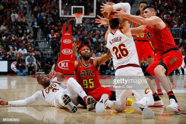 Ersan Ilyasova of the Atlanta Hawks battles for a loose ball against Kyle Korver of the Cleveland Cavaliers at Philips Arena on November 30 2017 in...