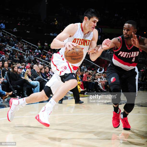 Ersan Ilyasova of the Atlanta Hawks drives to the basket against the Portland Trail Blazers during the game on March 18 2017 at Philips Arena in...