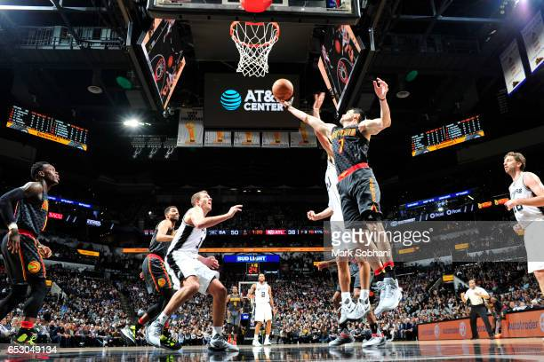 Ersan Ilyasova of the Atlanta Hawks grabs the rebound against the San Antonio Spurs on March 13 2017 at the ATT Center in San Antonio Texas NOTE TO...