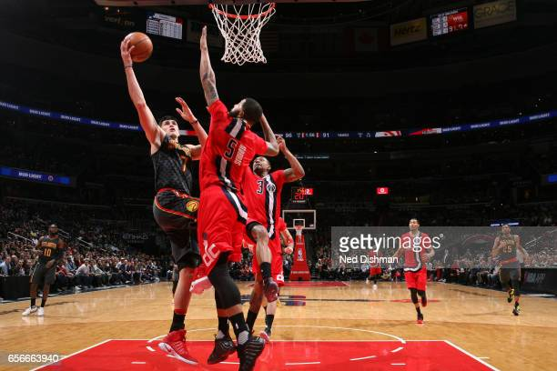 Ersan Ilyasova of the Atlanta Hawks shoots the ball against the Washington Wizards on March 22 2017 at Verizon Center in Washington DC NOTE TO USER...