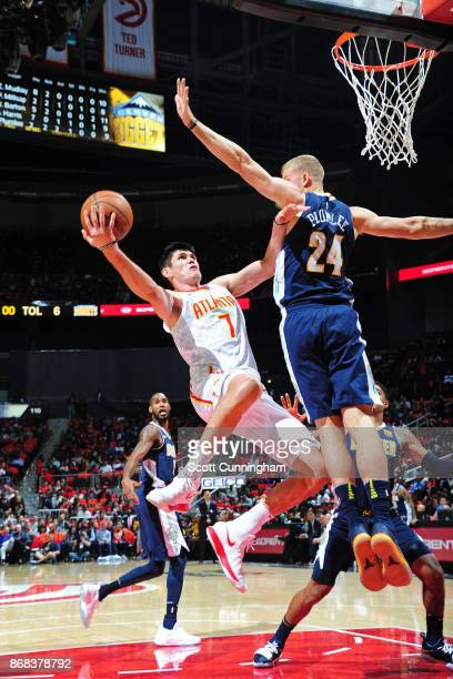 Ersan Ilyasova of the Atlanta Hawks shoots the ball during the game against the Denver Nuggets on October 27 2017 at Philips Arena in Atlanta Georgia...