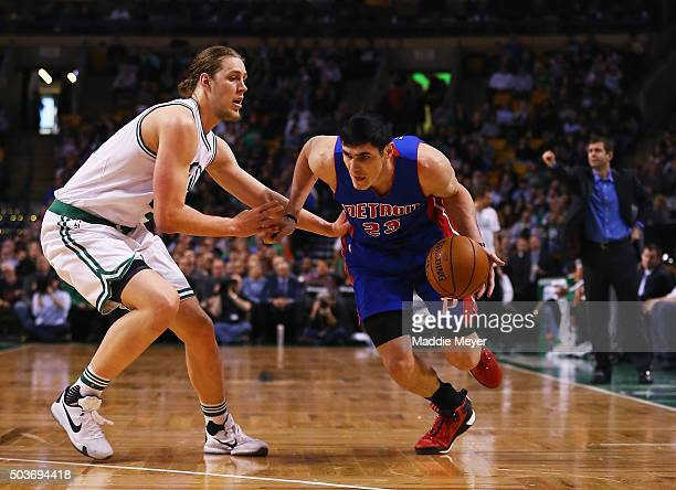 Ersan Ilyasova of the Detroit Pistons drives against Kelly Olynyk of the Boston Celtics during the first quarter at TD Garden on January 6 2016 in...