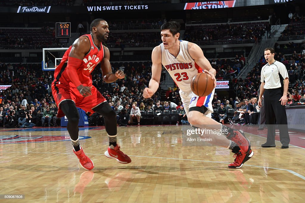 Ersan Ilyasova #23 of the Detroit Pistons drives to the basket against Patrick Patterson #54 of the Toronto Raptors on February 8, 2016 at The Palace of Auburn Hills in Auburn Hills, Michigan.