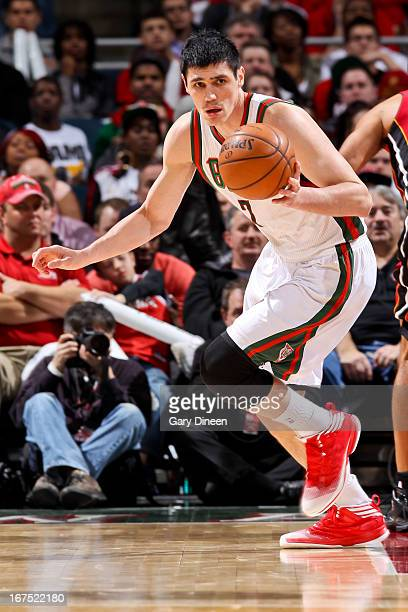Ersan Ilyasova of the Milwaukee Bucks advances the ball against the Miami Heat in Game Three of the Eastern Conference Quarterfinals during the 2013...