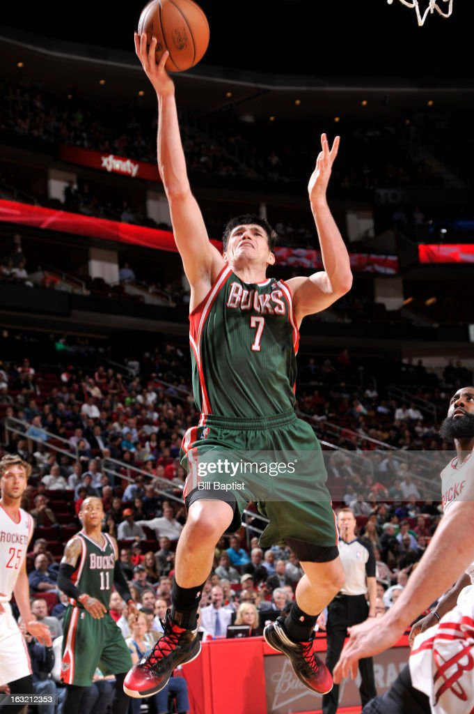 <a gi-track='captionPersonalityLinkClicked' href=/galleries/search?phrase=Ersan+Ilyasova&family=editorial&specificpeople=557070 ng-click='$event.stopPropagation()'>Ersan Ilyasova</a> #7 of the Milwaukee Bucks drives to the basket against the Houston Rockets on February 27, 2013 at the Toyota Center in Houston, Texas.