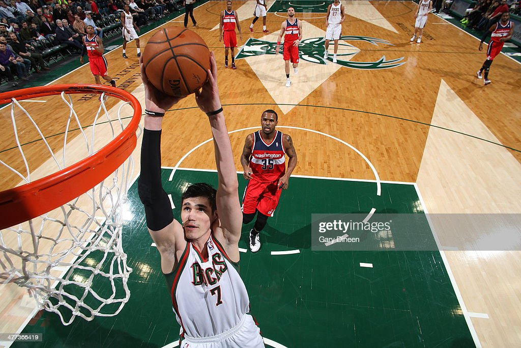 Ersan Ilyasova #7 of the Milwaukee Bucks dunks against the Washington Wizards on March 8, 2014 at the BMO Harris Bradley Center in Milwaukee, Wisconsin.