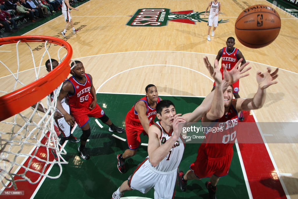 Ersan Ilyasova #7 of the Milwaukee Bucks fights for the rebound against Spencer Hawes #00 of the Philadelphia 76ers on February 13, 2013 at the BMO Harris Bradley Center in Milwaukee, Wisconsin.